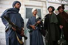 Taliban surrender their weapons. Credit: ISAF Media, via Flickr