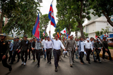 Sam Rainsy, the leader of the CNRP opposition party marches through the streets of Phnom Penh, Cambodia. By flickr user Luc Forsythe, under CC license