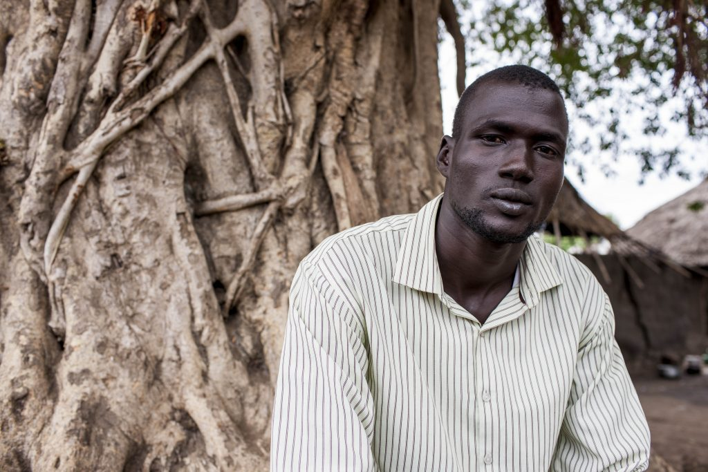 "Twic East, Jonglei. Makuey is a Dinka businessman working in a Nuer area when conflict broke out. He reached out to his friend Malakan, a Nuer, for help. ""Malakan told me that I should hide in his house. The men had intensified their searches, I had to leave. Malakan insisted on coming with me …We walked for 13 hours, he did not leave my side.I could not thank him enough…I am alive only because of him."" Photo: OXFAM/Stella Madete"